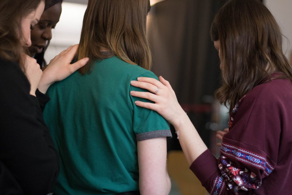 Two friends place a hand on the shoulder of another to comfort them. Group therapy in Pasadena, CA can provide similar support at Body Mind Psychology with Chris Tickner, LMFT. Contact us & learn about group trauma therapy in Pasadena, CA and other services.