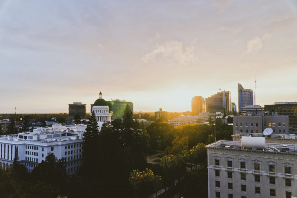 An image of a city skyline as the sun rises for California Integrative Therapy. Learn more about therapy in Sacramento, CA and the other services we offer. A trauma therapist in Sacramento, CA can address the issues that matter to you! 95835 | 95765 | 95747