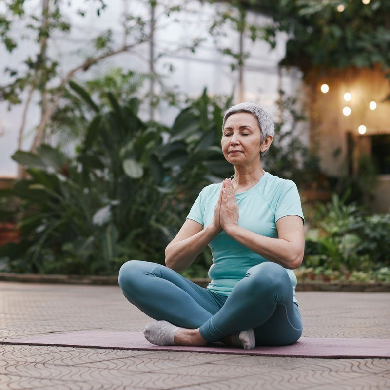A woman sits on a matt while meditating. This could symbolize how mindfulness can help treat anxiety symptoms. Contact an anxiety therapist for info on anxiety treatment in Sacramento, CA. We would be happy to provide panic attack treatment and other services to support you! 91101 | 95814 | 95688 | 95765